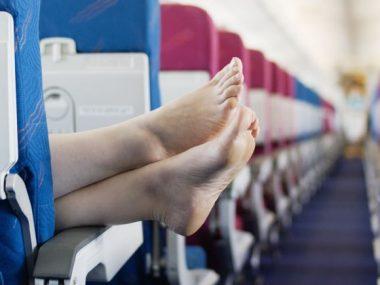 54401b6258544c134c0677a3_feet-on-airplane